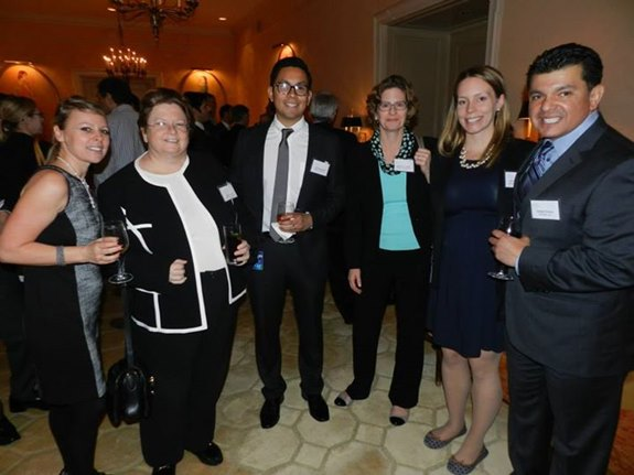 """Attendees enjoy the cocktail reception at our monthly meeting, where in-house attorneys detailed """"Best Practices in Patent Prosecution."""""""