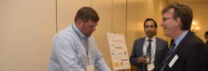 LAIPLA members and corporate sponsors talking at sponsor display table