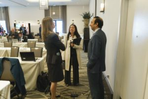 Ashe Puri (Fox Rothschild) talks with Erin Mehta of Hulu, and Ellen Lin of KaVo Kerr Group, after a session at Washington in the West 2019.