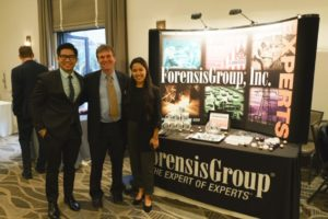 Mark Treitel with Diamond Sponsor Forensis Group booth at Washington in the West 2019